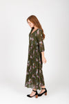 The Edward Floral Pleated Dress in Hunter Green, studio shoot; side view