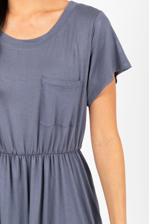 The Madeleine Casual Empire Dress in Shadow- studio shoot; close up front view of arm