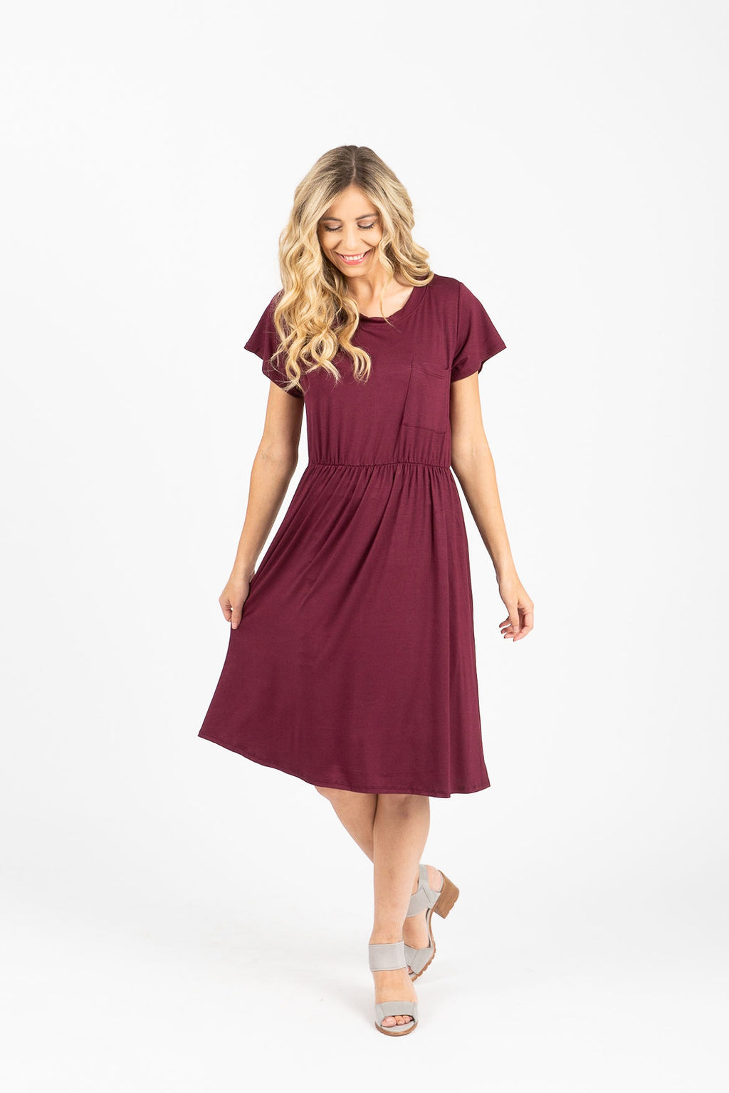 The Madeleine Casual Empire Dress in Plum- studio shoot; front view