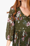 The Edward Floral Pleated Dress in Hunter Green, studio shoot; closer up front view