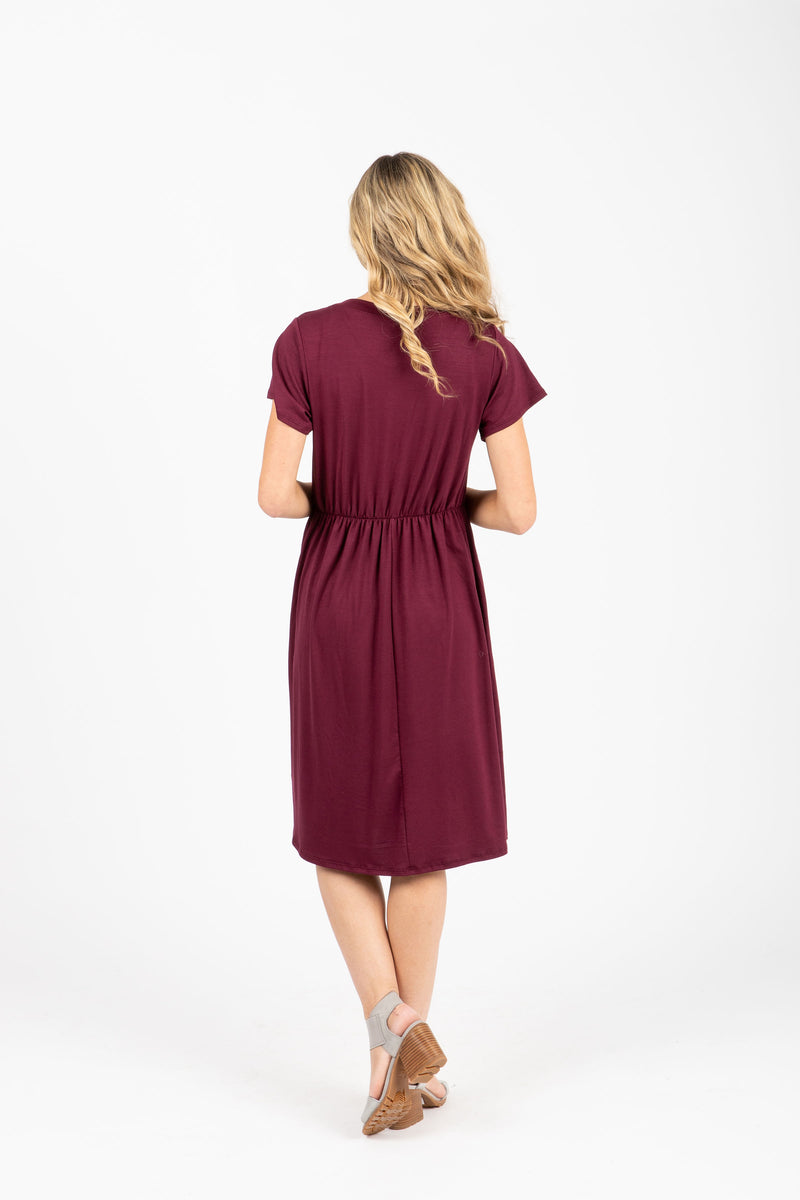 The Madeleine Casual Empire Dress in Plum- studio shoot; back view