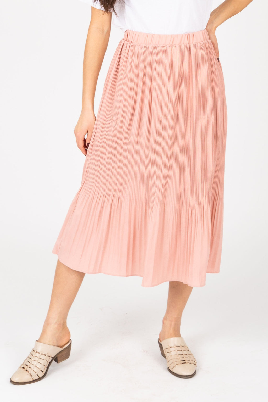 The Jana Pleated Midi Skirt in Dusty Rose, studio shoot; front view