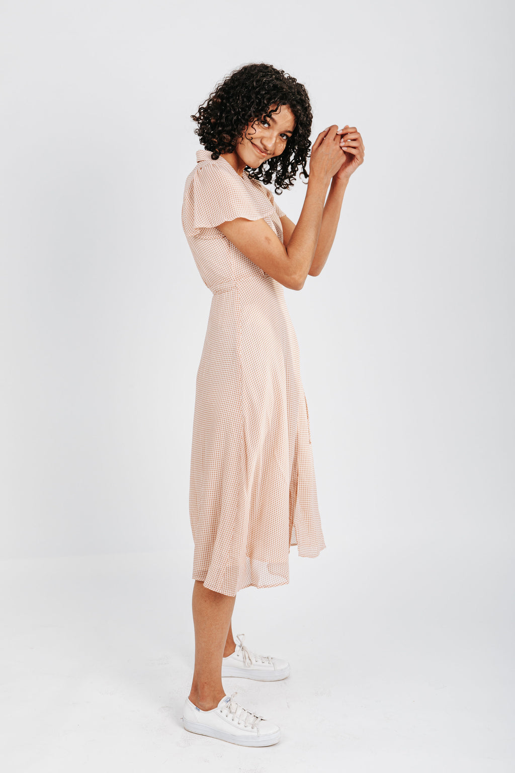 The Benfield Gingham Wrap Dress in Rust, studio shoot; side view