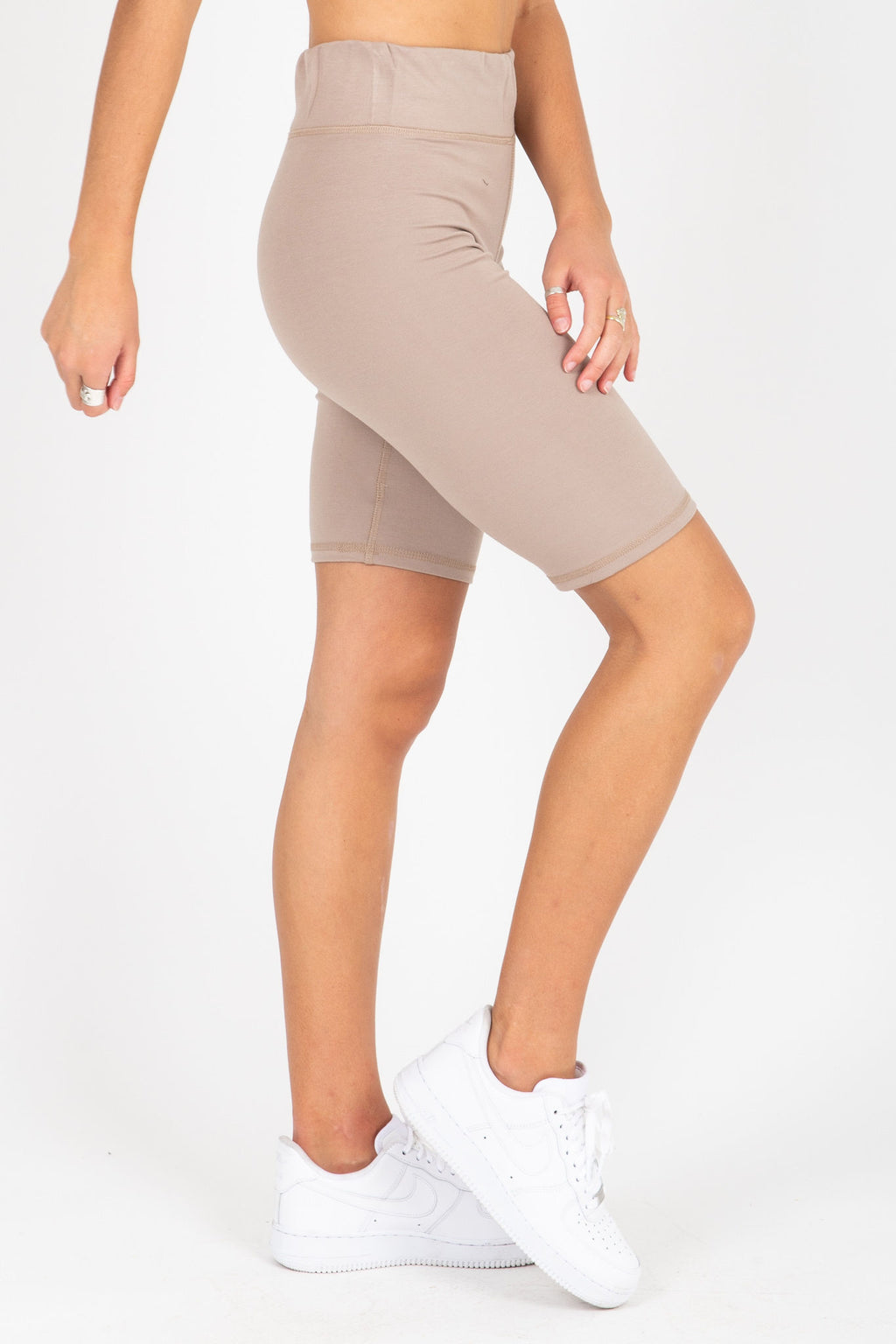 The Thick Knit Biker Short in Tan, studio shoot; side view