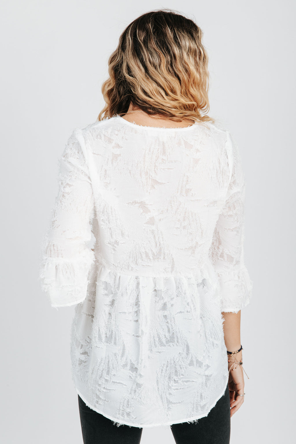 The Miguel Textured Blouse in Ivory, studio shoot; back view