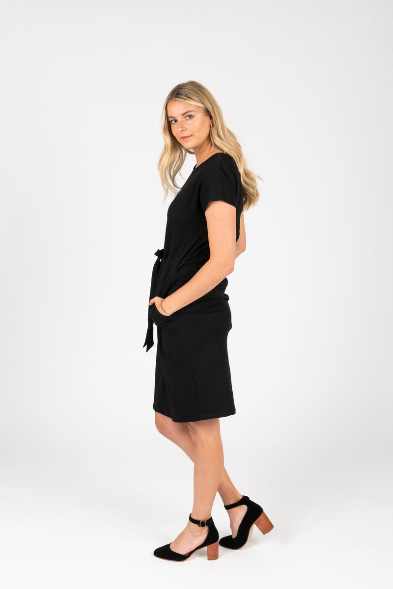 Piper & Scoot: The Casa Cinch Casual Dress in Black, studio shoot; side view