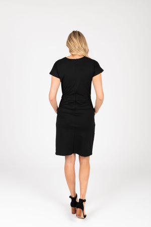 Piper & Scoot: The Casa Cinch Casual Dress in Black, studio shoot; back view