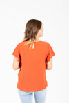 The Drake Embroidered Blouse in Clementine, studio shoot; back view