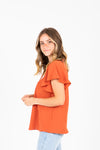 The Drake Embroidered Blouse in Clementine, studio shoot; side view