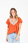 The Drake Embroidered Blouse in Clementine, studio shoot; front view
