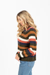 The Felix Striped Sweater in Multi, studio shoot; side view