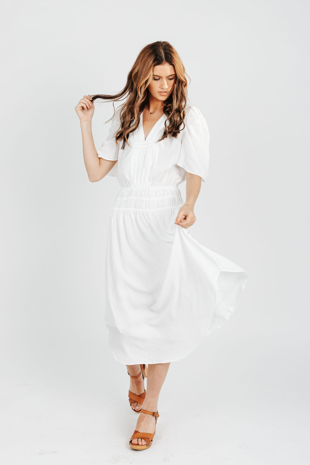 The Ivan Ruched Dress in White, studio shoot; front view