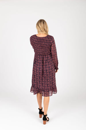 Piper & Scoot: The Emery Smocked Floral Dress in Navy + Rose, studio shoot; back view