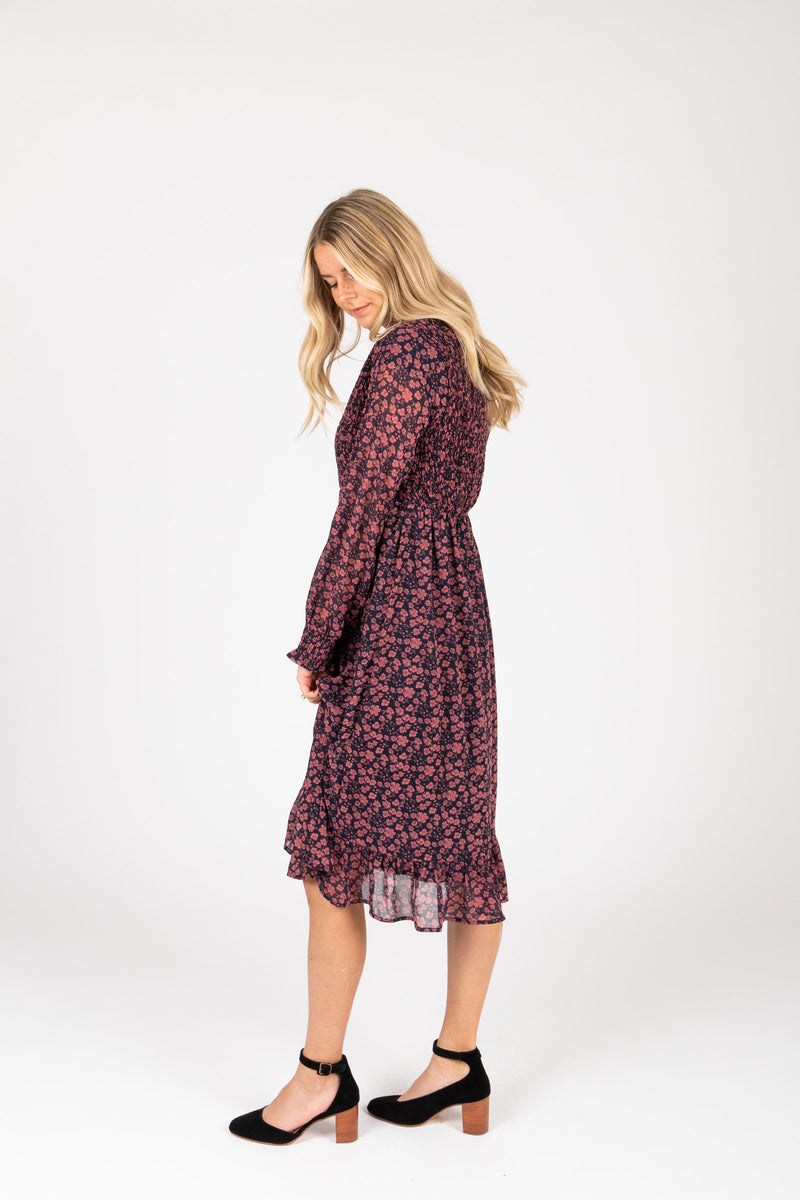 Piper & Scoot: The Emery Smocked Floral Dress in Navy + Rose, studio shoot; side view