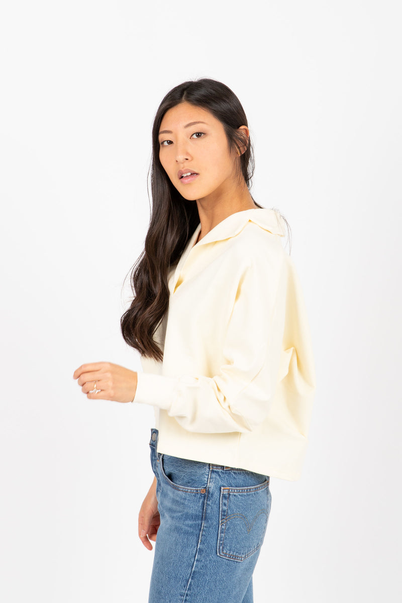 The Sadie Collared Sweater in Cream, studio shoot; side view