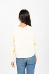 The Sadie Collared Sweater in Cream, studio shoot; back view