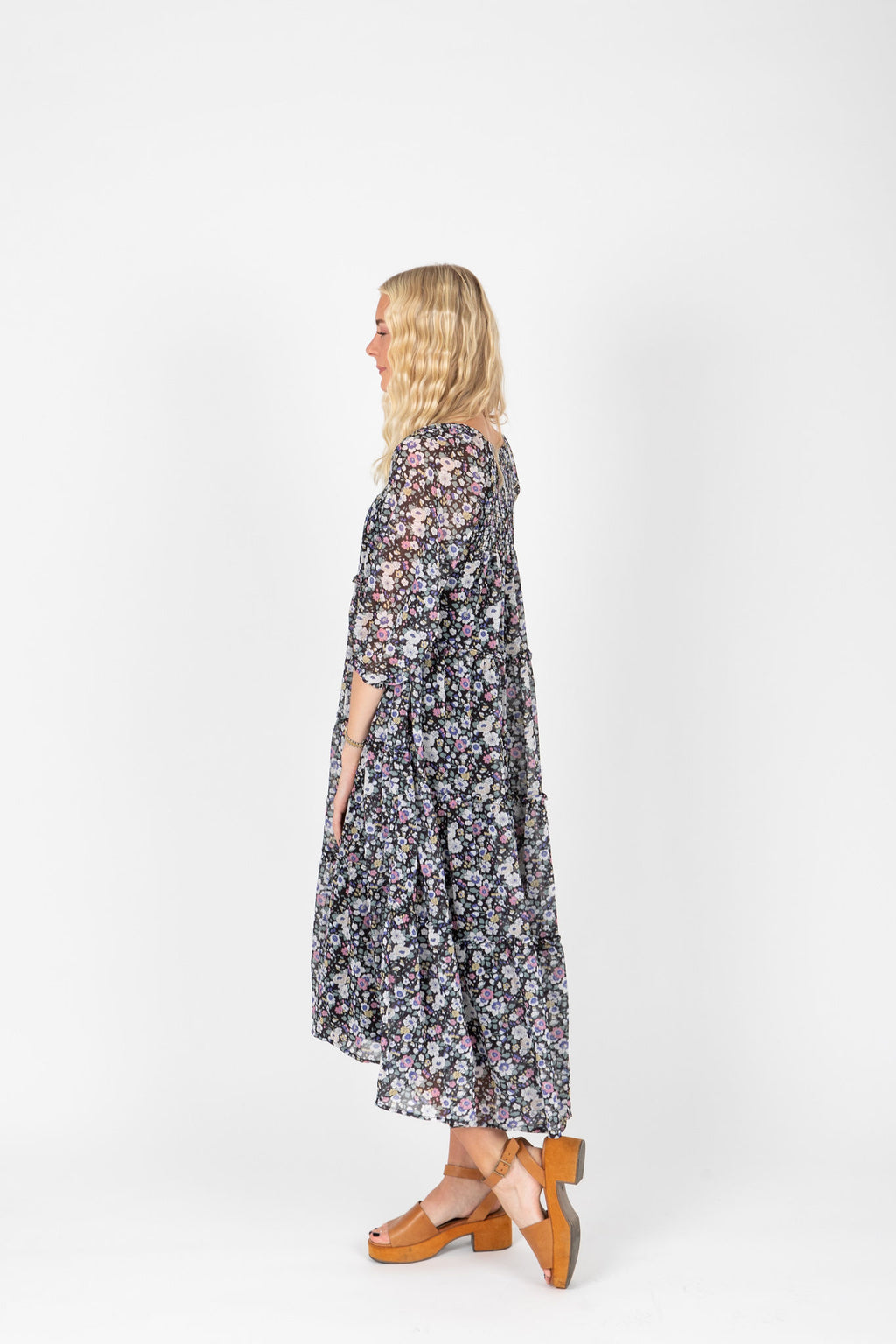 The Kaye Chiffon Floral Dress in Black, studio shoot; side view
