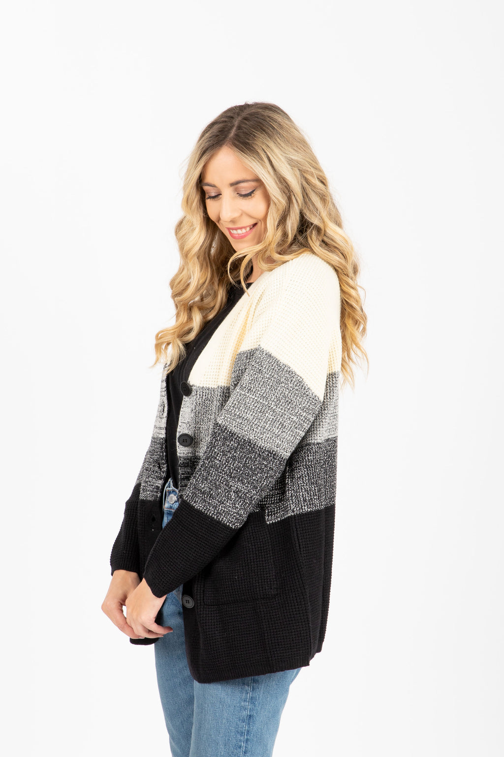 The Marston Block Cardigan in Black + Cream, studio shoot; side view