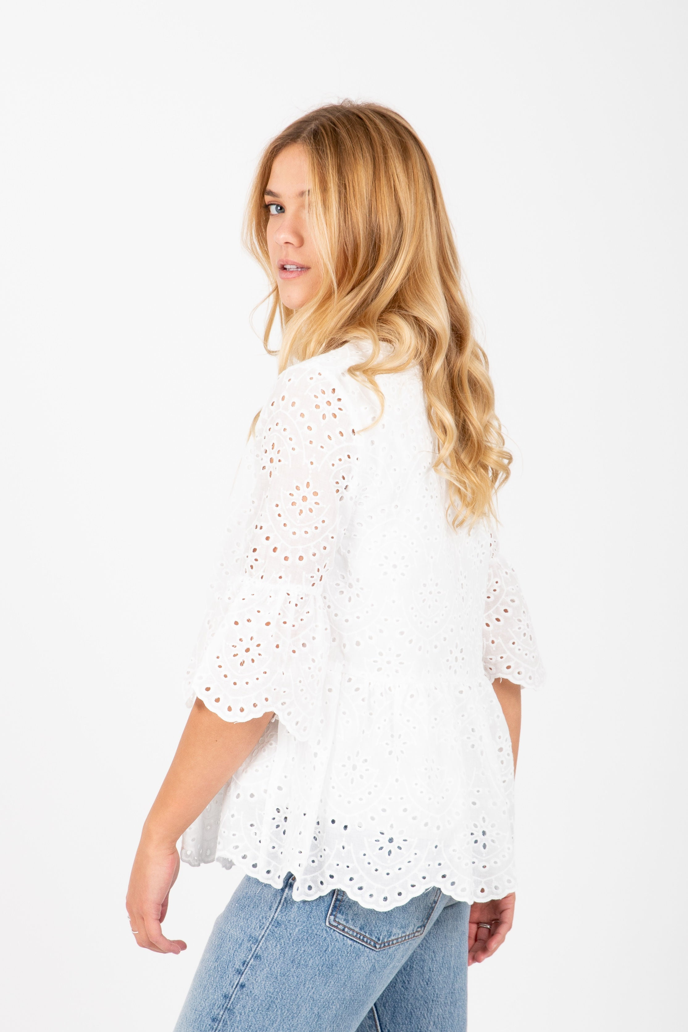 The Influential Textured Peplum Blouse in White