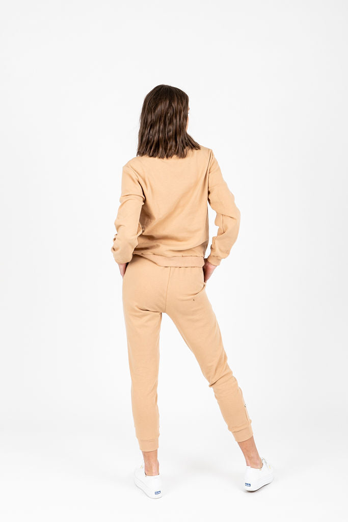 The Budd Floral Detail Jogger in Taupe, studio shoot; back view