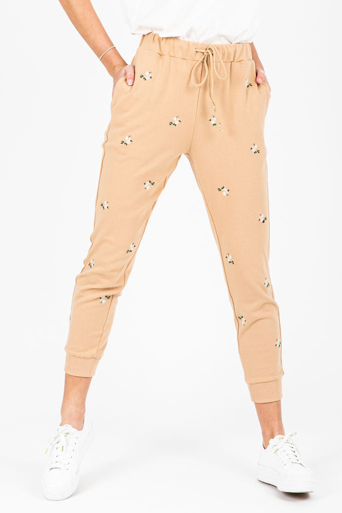 The Budd Floral Detail Jogger in Taupe, studio shoot; front view