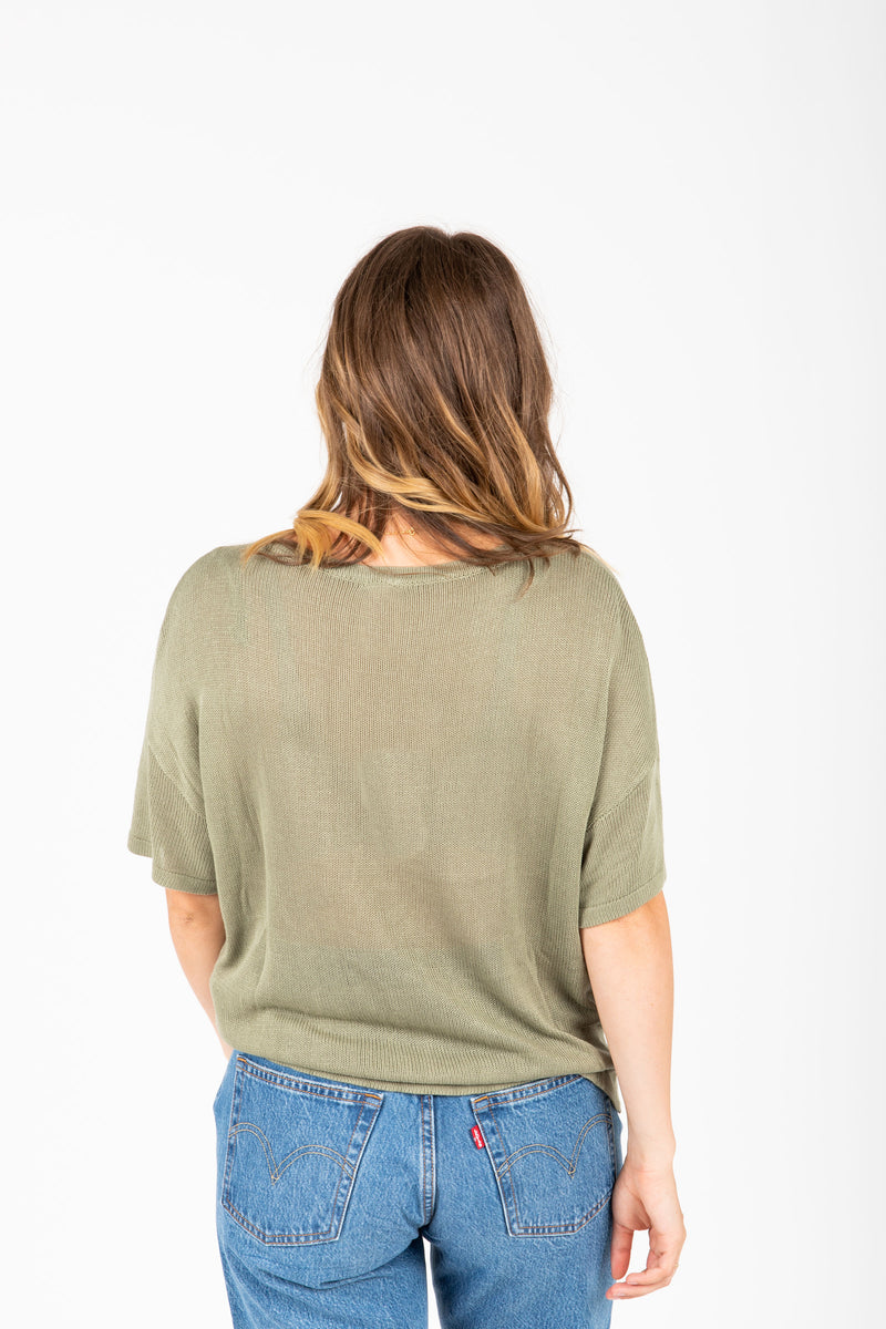 The Novak Knit Blouse in Rosemary, studio shoot; back view