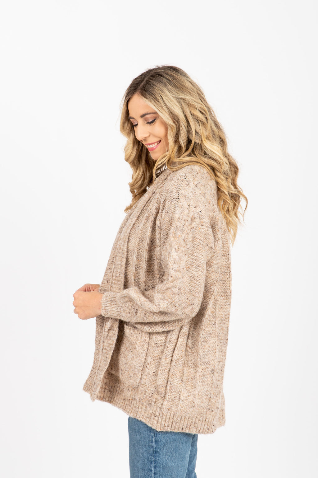 The Darby Crochet Knit Cardigan in Oatmeal, studio shoot; side view
