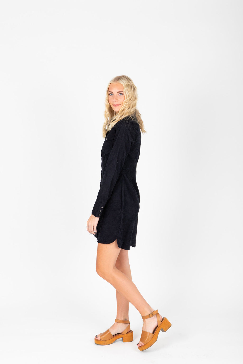 The Derwin Corduroy Dress in Midnight, studio shoot; side view