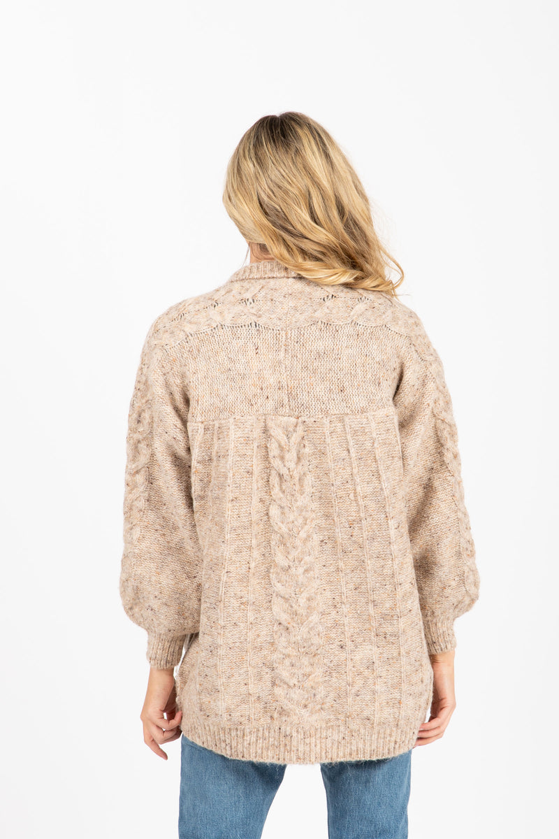 The Darby Crochet Knit Cardigan in Oatmeal, studio shoot; back view