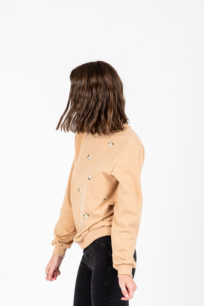 The Stevie Floral Detail Sweatshirt in Taupe, studio shoot; side view