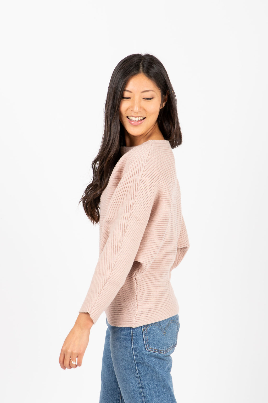 The Francis Ribbed Sweater in Dusty Blush, studio shoot; side view
