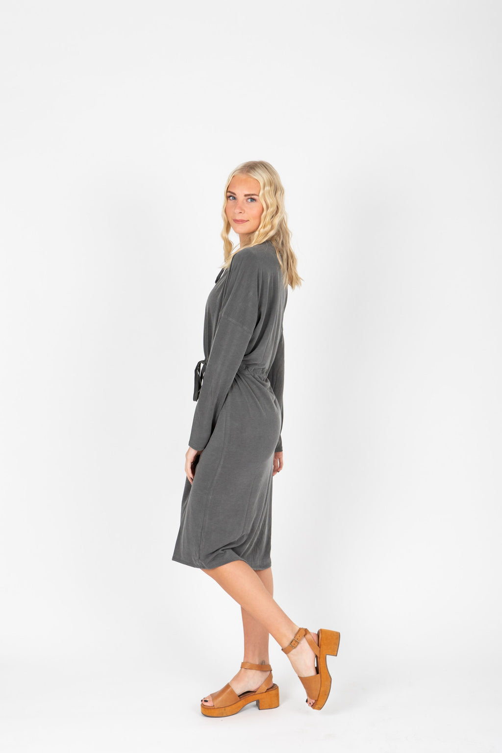 The Leena Casual Tie Dress in Slate, studio shoot; side view