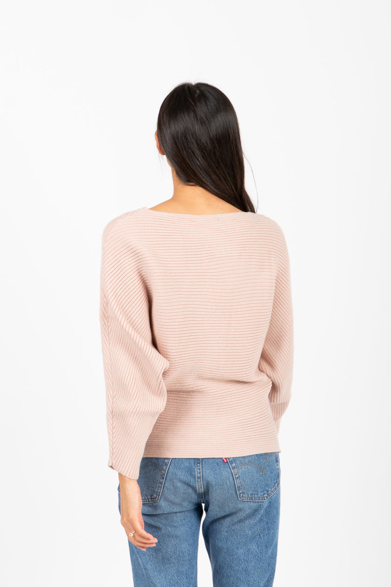 The Francis Ribbed Sweater in Dusty Blush, studio shoot; back view