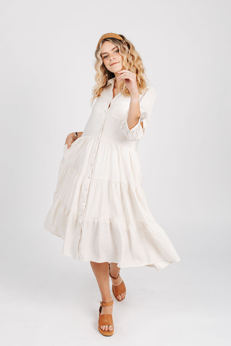 The Joyce Tiered Button Down Dress in Ivory, studio shoot; front view
