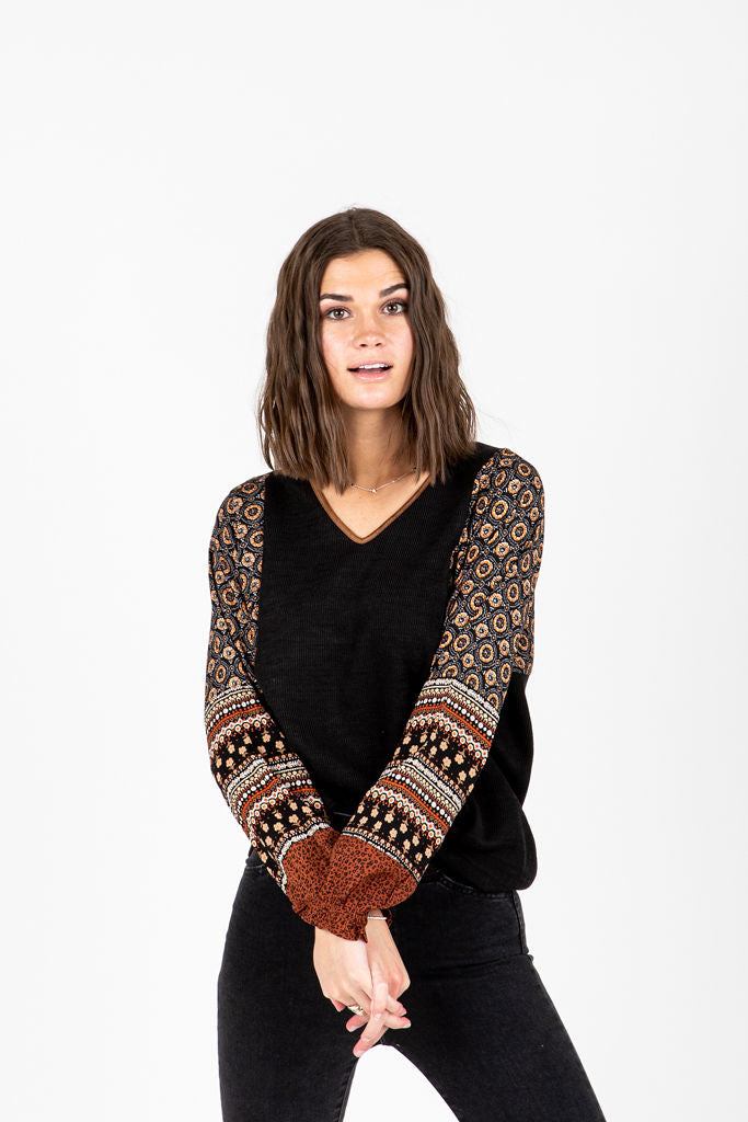 The Eliza Patterned V-Neck Blouse in Black, studio shoot; front view