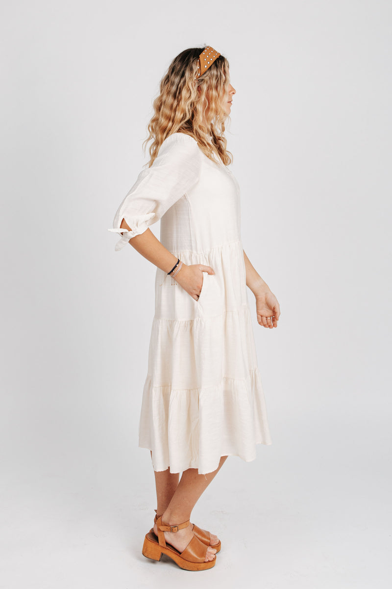 The Joyce Tiered Button Down Dress in Ivory, studio shoot; side view