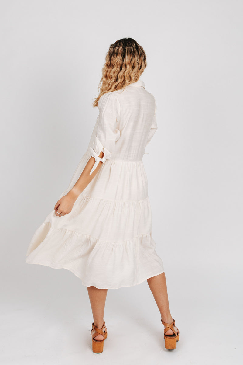 The Joyce Tiered Button Down Dress in Ivory, studio shoot; back view