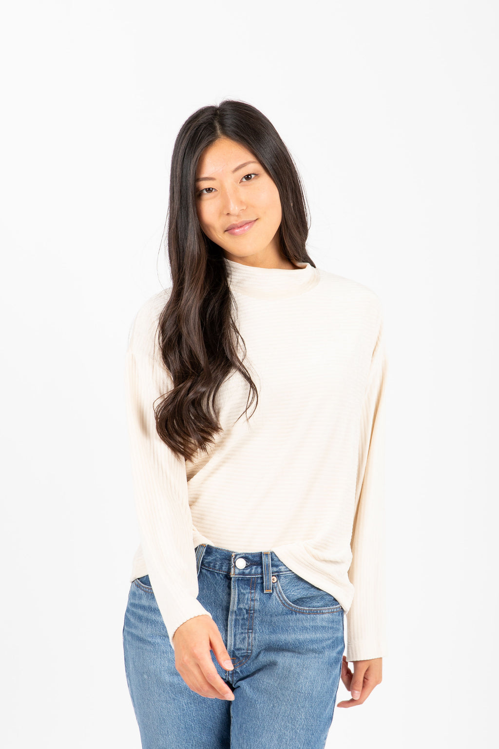 The Virgina Ribbed Mock Neck Sweater in Cream, studio shoot; front view