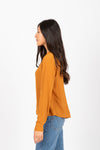 The Devon Draped Button Blouse in Ginger, studio shoot; side view