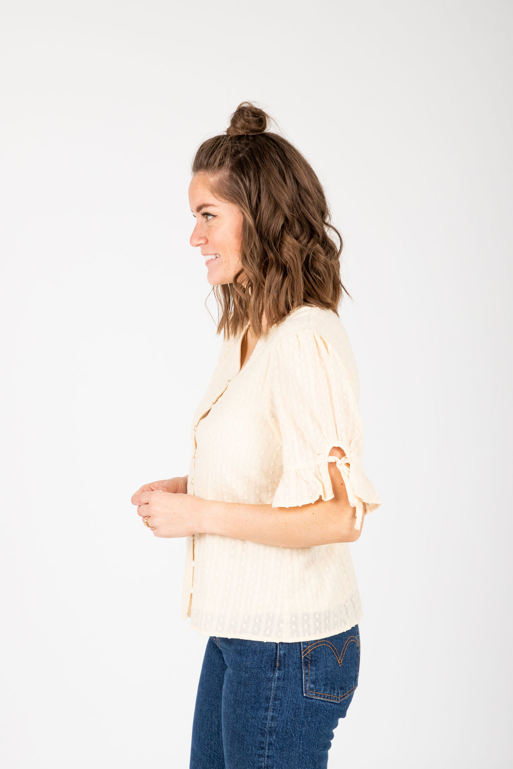 The Giavanna Detailed Button Blouse in Cream, studio shoot; side view