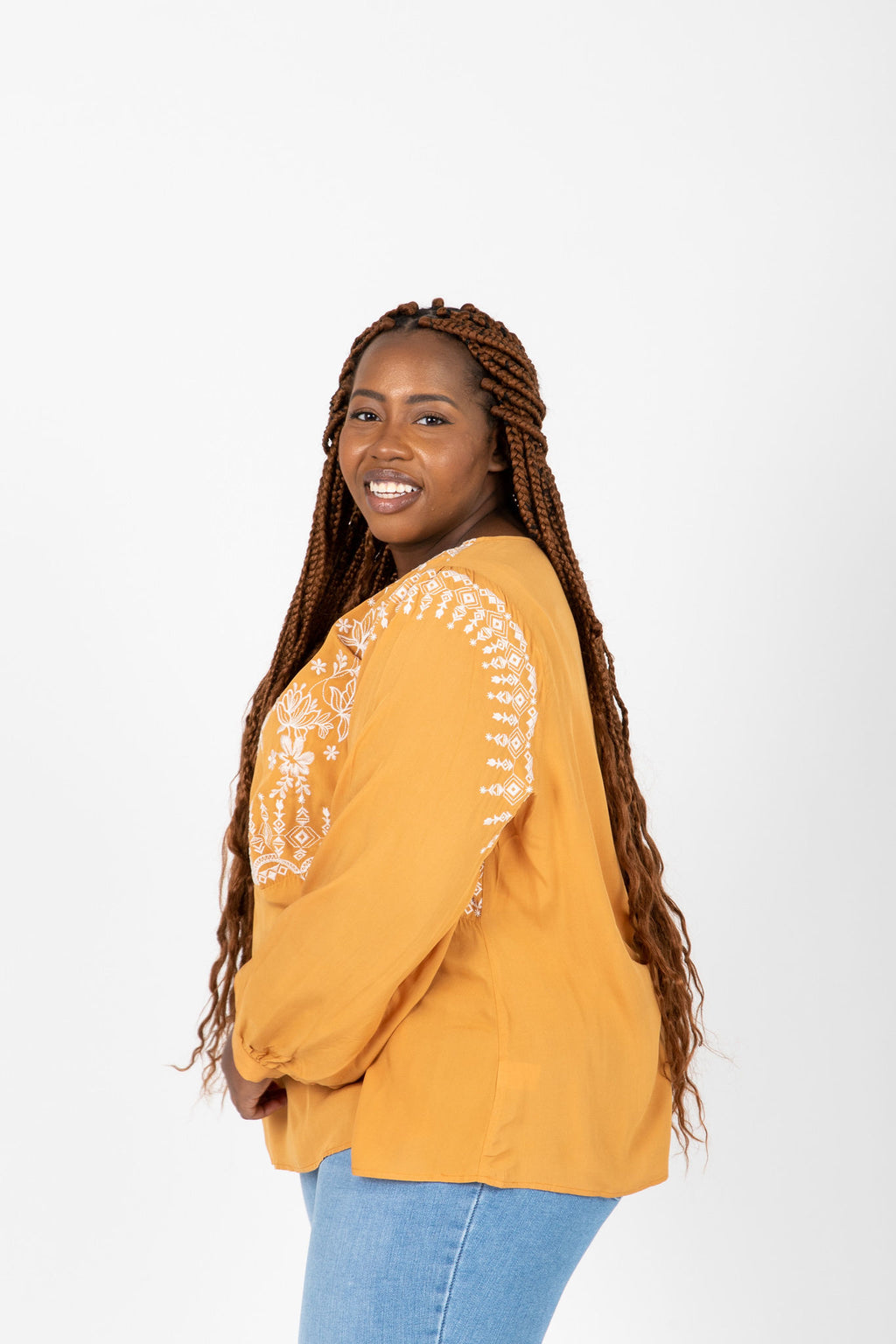 The Mary Beth Embroidered Blouse in Mustard, studio shoot; side view