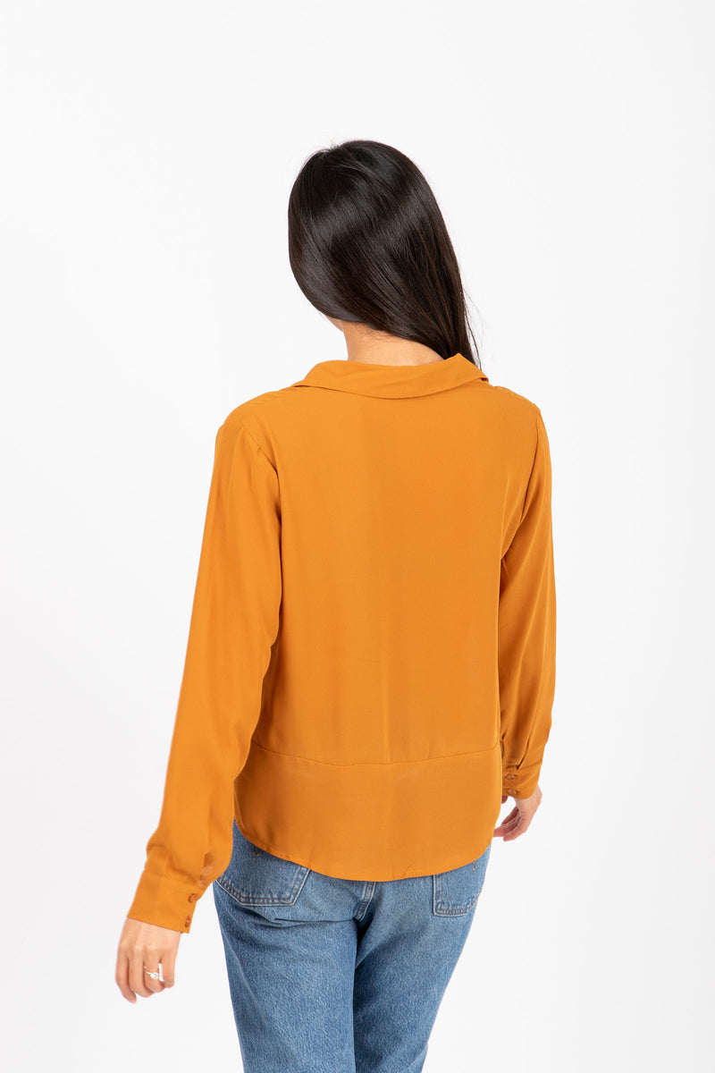 The Devon Draped Button Blouse in Ginger, studio shoot; back view