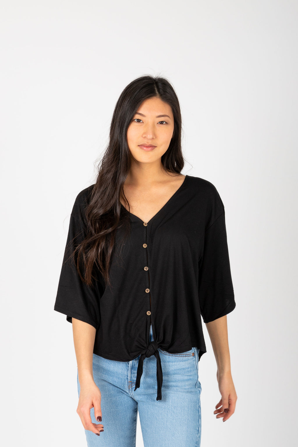 The Espen Button Tie Front Blouse in Black, studio shoot; front view