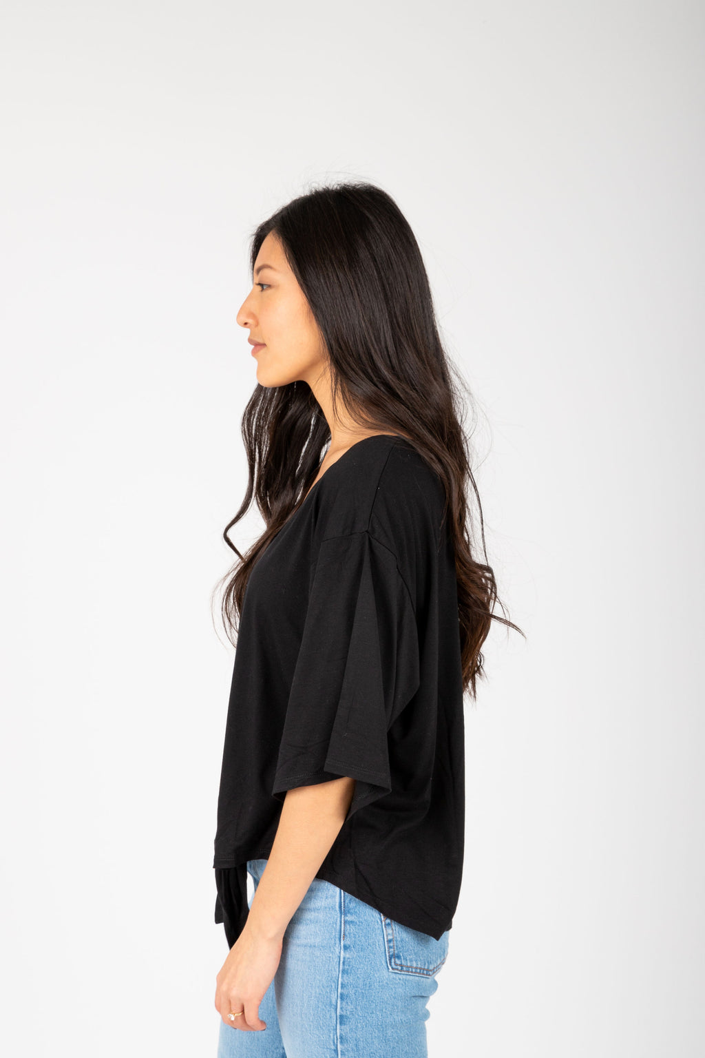 The Espen Button Tie Front Blouse in Black ,studio shoot; side view