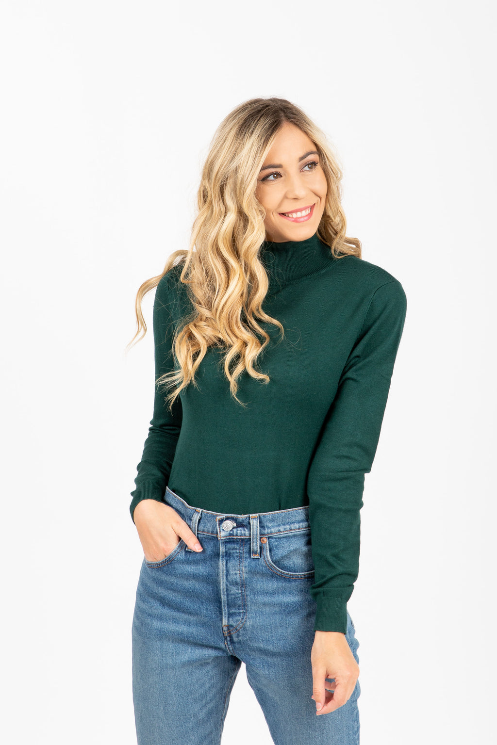 The Tate Turtleneck Sweater in Hunter Green, studio shoot; front view