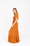 The Veruca Smocked Tiered Dress in Camel, studio shoot; side view