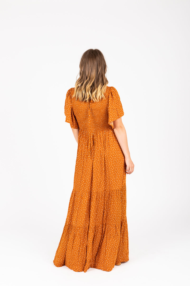 The Veruca Smocked Tiered Dress in Camel, studio shoot; back view
