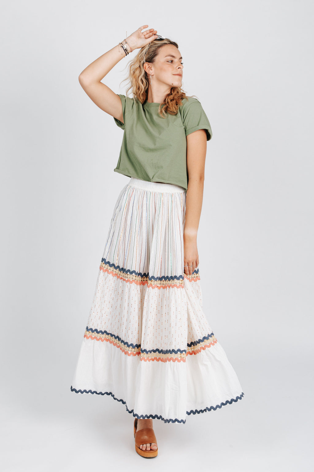The Seneca Shimmer Maxi Skirt in Ivory, studio shoot; front view