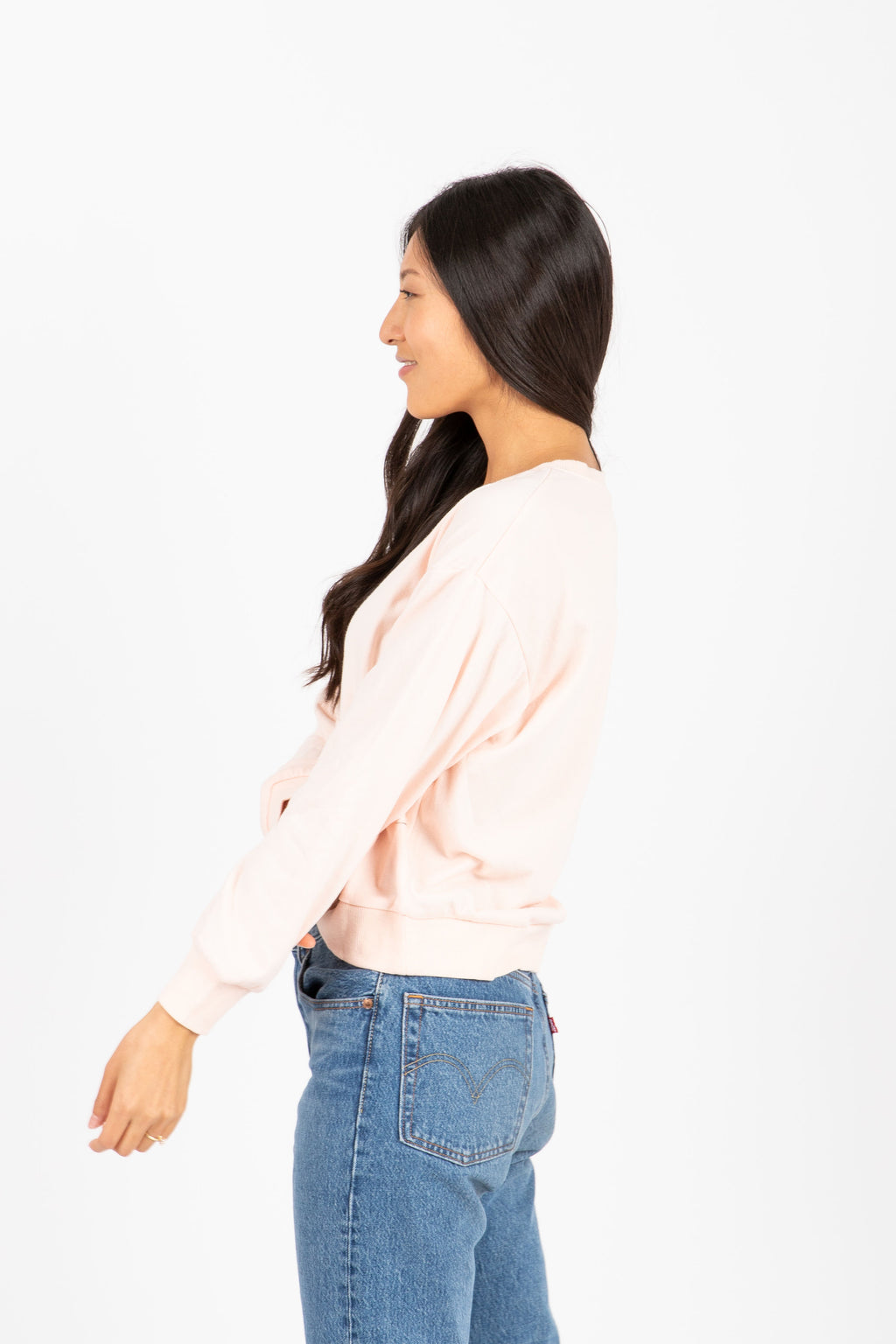The Oui Oui Crew Neck Sweatshirt in Blush, studio shoot; side view