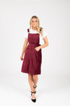The Dottin Corduroy Jumper Dress in Burgundy, studio shoot; front view